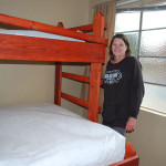 Gwendolyn, our Staff, shows off the beds!
