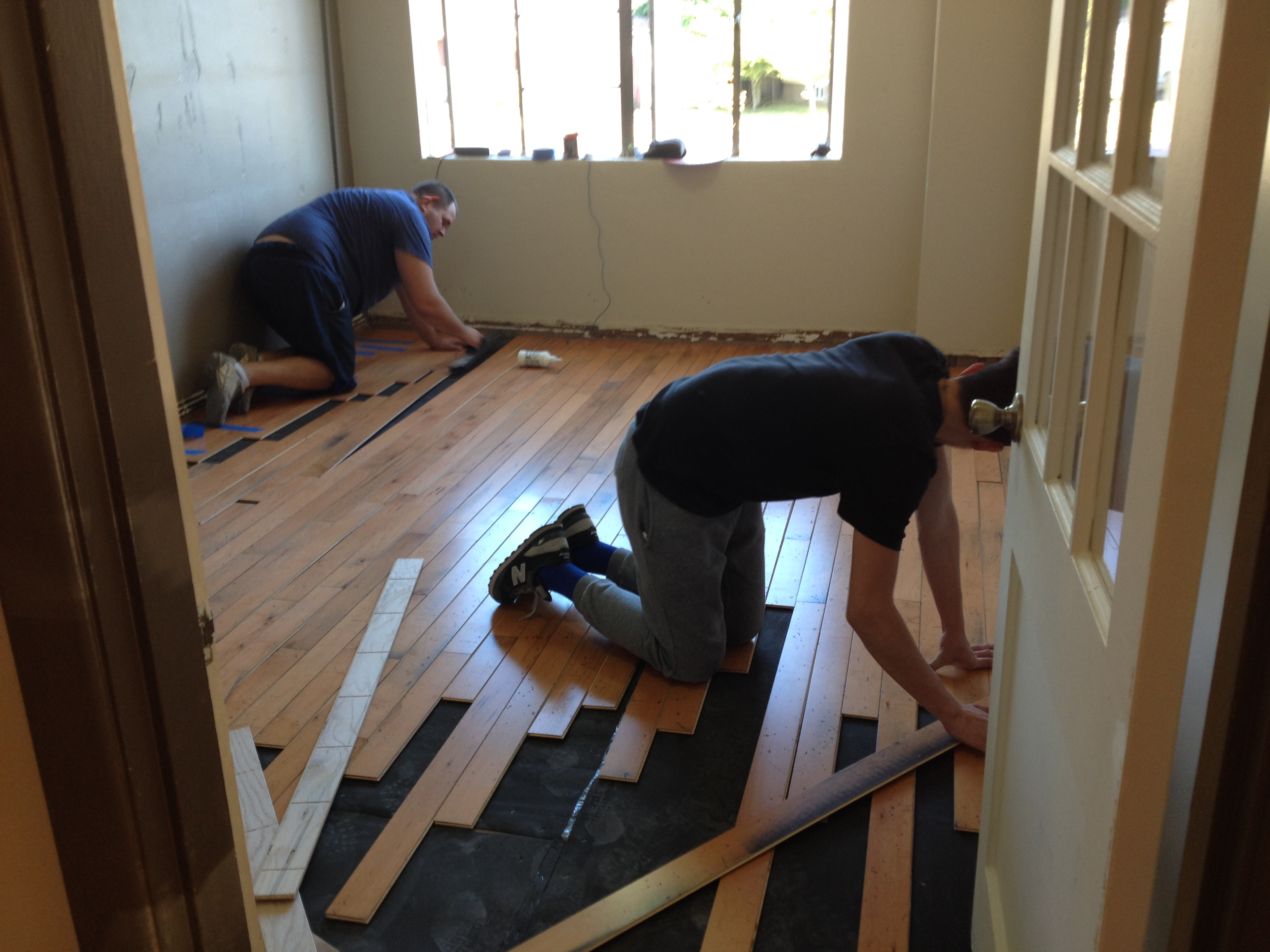 Workers From Macadam Floor U0026 Design Are Laying The New Floors With Material  Donated Through The