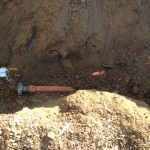 Here it the pipe next to the vault that will hold the equipment for the sprinkler just outside our building.