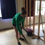 Vacuuming the garbage off the new bedroom floors to prepare for new flooring