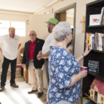 Guests check out the bookcase in our newly remodeled living/dining room