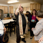 Fr. Mark Bachmeier, Pastor of Holy Cross Church, blessed the kitchen their congregation raised money to renovate.