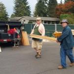 Carrying lumber.