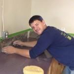 Josh installed the back splash in the kitchen using tiles Jim donated.