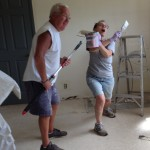 Larry and Nancy have fun painting the kitchen