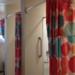 Carol made and hung shower curtains in the shower room.