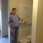Linda Jo shows off the newly painted showers. She's so happy to have them almost ready!