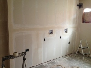 Here's the new wall that covers all those pipes in the laundry room.