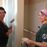 Volunteers from St. Johns Covenant and Holy Cross primed out new bathroom.