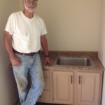 Dick found this cabinet and bought it and the counter top. Then he cut a hole just the right size for the sink. Amazing work for his first time ever doing it!