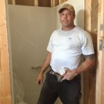 JP of ACT Plumbing with the shower in the ADA bathroom. He is doing a great job!