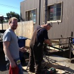Grant led the team. He's overseeing the guy fitting the pipes. It's a hot job on a hot day!