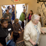 Excited volunteers, donors, contractors, and community members poured into the building.
