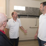 Dale and Rob show off the new wheelchair accessible bathroom