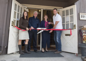 Brenda Ketach and Ken Cowdery of Home Builders Foundation, Linda Jo Devlaeminck, Program Director, and Dale Hosely of Clear Water Construction cut the ribbon.