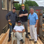Volunteer deck building crew